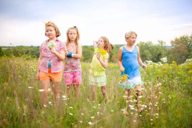 The children pictured are participating in a weekend summer camp created by parents in support and celebration of their gender-nonconformity.